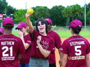 April Dean receives a game ball at Buddy Baseball, an organization that allows children with disabilities to participate in team sports with the help of on-field assistants who provide physical and emotional support. (Photo courtesy of Russ Oberbroeckling)
