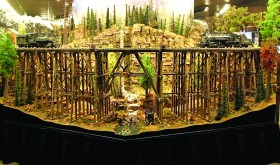 The trees, the tracks and the waterfall give this model train railroad layout a feeling of authenticity. (Photo courtesy of Suncoast Center for Fine Scale Modeling)