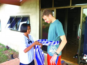 Hunter Rasmussen's village 'sister' Khwan presents him with some traditional fabric that was woven by hand. (Courtesy of Hunter Rasmussen)
