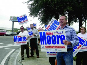 Mike Moore waving signs in Land O' Lakes.