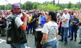Dan Turner, left, and his wife Cheryl address bikers in front of the Pasco County Government Center on U.S. 41 last year, ahead of their ride to honor members of Pasco County's Fire Rescue as part of the Pasco County Choppers 9/11 Gratitude Ride. (File Photo)