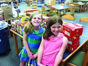 Kensington Mize, left, and her sister Maryalice are involved in an effort at Connerton Elementary School to help ensure no students attending their school go hungry over the weekend. (Courtesy of John Mize)