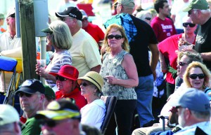 With limited room for dancing, Cindy Crismon of Zephyrhills, center, managed to strut her stuff in the crowd while jamming to the music of The Lauren Mitchell Band. This was her first Pigz In Z'Hills BBQ & Blues Fest. She is a winter resident from Lake Orion, Michigan. (Fred Bellet/Photo)