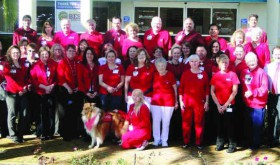 """Members of the staff and volunteers at Regional Medical Center Bayonet Point gathered for a group photo on National Wear Red Day on Feb. 7. Even """"Lucky,"""" the hospital's therapy dog, got into the act. (Courtesy of Regional Medical Center Bayonet Point)"""