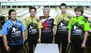 From left, Donna Fernandez, 14, of Land O' Lakes; Jacob Kostoff, 15, of Trinity; Coach Lucy Sandelin; Alec Ballard, 16, of Land O' Lakes; and Chandler Carr, 14, of Lutz will compete in an upcoming state tournament. Fernandez and Kostoff also will compete in the Jr. Gold Championship this summer in Chicago. (Fred Bellet/Photo)