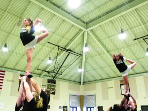 Practice and teamwork have helped Pasco-Hernando State College's cheerleading squad claim a state title. (Michael Murillo/Staff Photo)