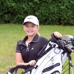 Young golfer hits links, brings home hardware