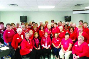 The GFWC Lutz-Land O' Lakes Woman's Club members were decked out in a sea of red at a recent general meeting in support of February as Heart Health Month.  (Courtesy of Patricia Serio)