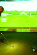 Golfer's Grail owner Jeff Sproat works in Tampa, but he can take on a driving range, or even Augusta, anytime he wants. Golfers have 66 options on the simulators, plus putt-putt courses and other games.  (Michael Murillo/Staff Photo)