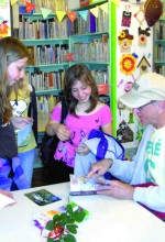 Children at libraries in Poland lined up to get autographed copies of Wendell Speer's book, 'Simon Peppercorn, Log in to Magic Space.' (Courtesy of Wendell Speer)