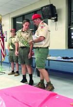 Scouting is important to Sam Crawford, who will attend Steinbrenner High School this fall. He's also working toward his Eagle Scout designation with a project that benefits the Old Lutz School. Shown here, he is standing next to Scoutmaster Jeff Potvin. Joey Hermes, another scout, is in the background. (Photos courtesy of Sam Crawford)