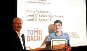 Colby Tomasello, right, receives a congratulatory handshake from Toshiba America Inc. executive R. Steven Tungate for his participation in the 2015 TOMODACHI Toshiba Science & Technology Leadership Academy in Tokyo.