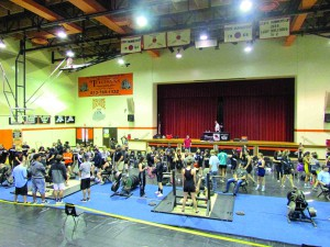 Several teams from the Eastside tournament go through bench press warm-up drills. (Kevin Weiss/Staff Photo)