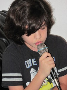 Max Karafilis is the lead singer in a rock band called Beyond Chaotic. The kids are all 12 or younger, but they have bold ambitions and big dreams.