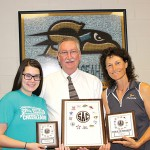 Sunlake cheerleader, coach receive county honors