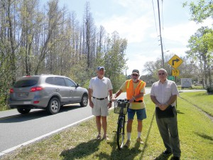 Leonard Road residents want the county to build a sidewalk to protect pedestrians and bicyclists. On a recent afternoon, a motorist in a car drove past, from left, Mike Benjamin, David Haynes and Ed Klaameyer. (Kathy Steele/Staff Photo)