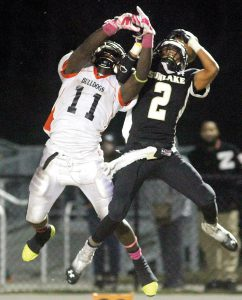(File Photo) Antwione Sims, left, goes up for a ball against former Sunlake player Terrence Jackson. The Zephyrhills Bulldogs will be without the star running back for a portion of the 2016 season due to a torn ACL. Sims rushed for a school-record 2,093 yards last season, helping to lead the Bulldogs to an 8-3 record.