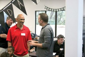Tony Dungy, left, has a chat with John Viscardo, one of the dads in attendance. (Photos courtesy of Lutz Learning Center)