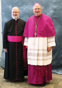 The Rev. Ron Aubin, left, of Our Lady of the Rosary, has received the title of monsignor. He is shown here with the Most Rev. Robert Lynch, Bishop of the Diocese of St. Petersburg. (Courtesy of Our Lady of the Rosary Catholic Church)