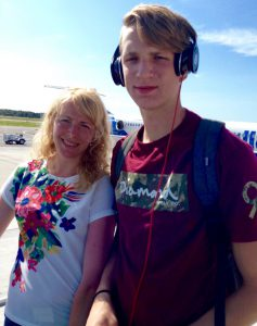 Daniil Shcherbinin with his mom, Katarina Ilina, at an airport.