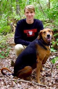 Daniil Shcherbinin and Sam, a rescue coonhound mix, in the woods near their Land O' Lakes house. (Photos courtesy of Eric Wilson)