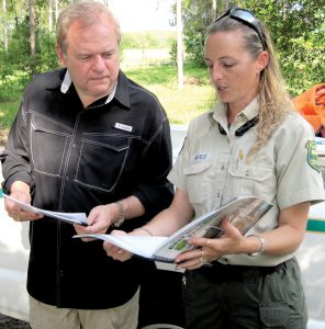 Jake English and Mona Neville discuss plans for managing English's pine forest, and also talk over some cost-sharing programs available through Florida Forest Service. (B.C. Manion/Staff Photos)