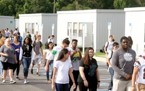Students stream out of the portable classrooms at Wiregrass Ranch High School during a class change last school year. The school will again have a 10-period day, to relieve crowding on campus by staggering the time that students arrive and leave the campus. (Fred Bellet/Photo)
