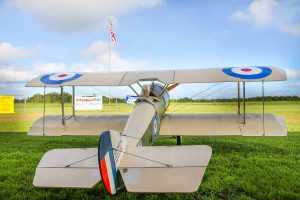 A one-third scale model Sopwith sits at the ready, within clear view of the American flag.