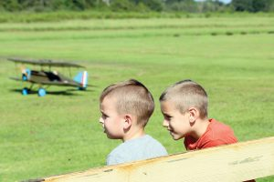 Two brothers from Hudson, Jett and James Strahan who are ages 3 and 6, appear to be enjoying the air show. The event was open to all, and people of all ages appeared to be having fun watching the planes.