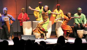 The beat of the drums brings out dancers during a segment of the Watoto Children's Choir performance at the Van Dyke Church.