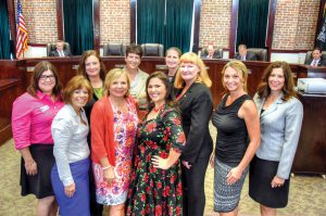 Pasco County commissioners agreed to establish a Commission on the Status of Women. Following the vote, several women who worked to have the commission approved marked the occasion with a photo. From left, in front row, Stefanie Pontlitz, Minnie Diaz, Pasco County Commissioner Kathryn Starkey, Rosie Paulsen, Pasco County Administrator Michele Baker, Shawn Roetschke, and Nikki Alvarez-Sowles, of the Pasco County Circuit Court. Back row, Assistant County Administrator Heather Grimes, Assistant County Administrator Cathy Pearson and Assistant County Attorney Elizabeth Blair. (Photos courtesy of Richard K. Riley)