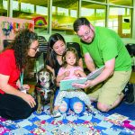 Charlie the Dog helps children read at local library