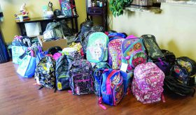 Fighting child hunger in Pasco, one backpack at a time